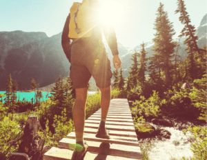 Man hiking in the woods by a lake